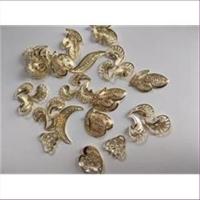 10 filigrane Pressungen goldfarbig